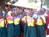 Katwe Primary School Refugee students expressing their happiness after recieving Mestraution Materials