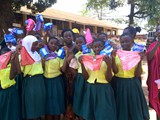 Katwe Primary School Refugee students expressing their happiness after recieving Mestraution Materials-
