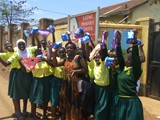 Katwe Primary School Refugee students expressing their happiness after recieving Mestraution Materials---